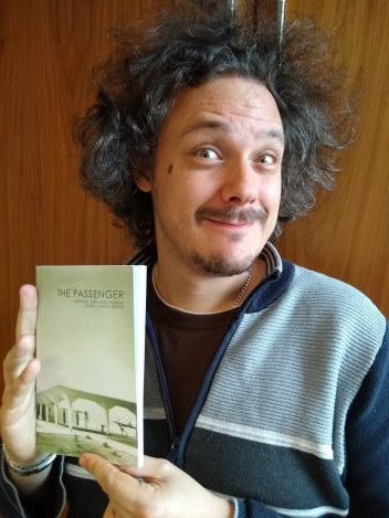 James - holding an Open Access book! Image credit: James L. Smith.